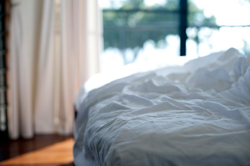 Unmade bed with white bed linen Unmade Beds